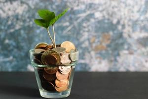 Saving money in a jar photo